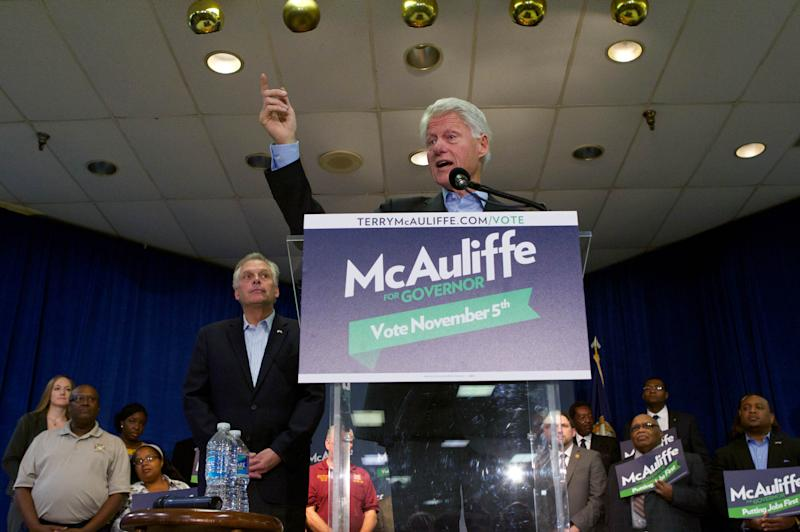 """Former President Bill Clinton campaigns for Democratic Virginia gubernatorial candidate, Terry McAuliffe, centerleft, during a """"Putting Jobs First"""" events in Dale City, Va., Sunday, Oct. 27, 2013. (AP Photo/Molly Riley)"""