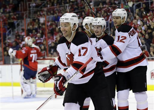 New Jersey Devils right wing Ilya Kovalchuk (17), from Russia, smiles after his goal in the second period of an NHL hockey game against the Washington Capitals Saturday, Feb. 23, 2013 in Washington. (AP Photo/Alex Brandon)