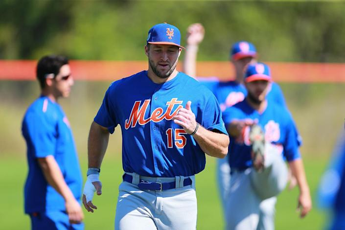 <p>Former Heisman Trophy winner Tim Tebow stretches during workouts at the New York Mets spring training facility at First Data Field in Port St. Lucie, Fla., Sunday, Feb. 26, 2017. (Gordon Donovan/Yahoo Sports) </p>