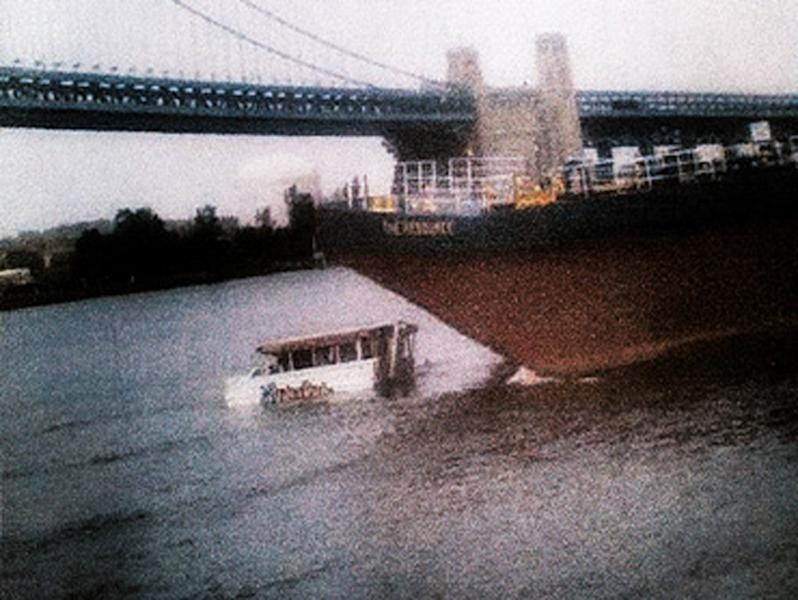 FILE - In this July 7, 2010, file photo, released by CBS3 (KYW-TV) in Philadelphia, a barge approaches a stalled duck boat on the Delaware River resulting a deadly collision in Philadelphia. Just days before a civil wrongful death lawsuit goes to federal court, attorneys for the parents of two Hungarian students killed when a barge slammed into a tour boat in Philadelphia nearly two years ago released a new video of the crash. A spokesman for the plaintiffs' attorneys says the video, released Tuesday, May 2, 2012, shows the impact of the barge and tour boat from the Camden, N.J., side of the river. It was part of the official record compiled by the National Transportation Safety Board, which investigated the crash. (AP Photo/CBS3 KYW-TV, File) MANDATORY CREDIT; NO SALES