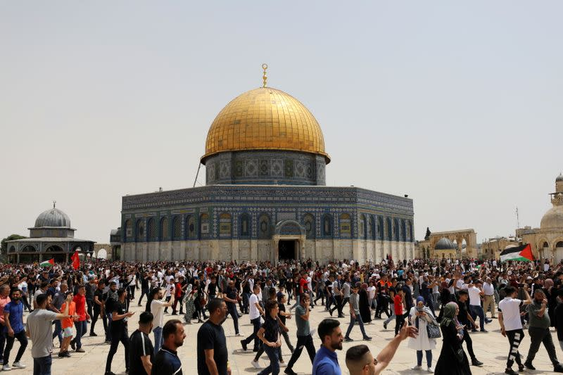 Palestinians walk at the compound that houses Al-Aqsa Mosque in Jerusalem's Old City