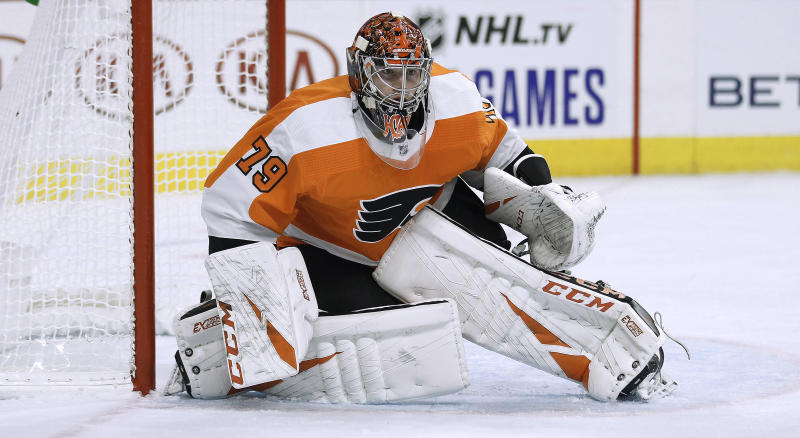 Philadelphia Flyers goalie Carter Hart, without his stick, guards the goal crease during the third period of the team's NHL hockey game against the New Jersey Devils on Wednesday, Oct. 9, 2019, in Philadelphia. The Flyers won 4-0. (AP Photo/Tom Mihalek)