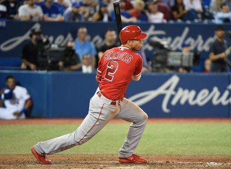 May 23, 2018; Toronto, Ontario, CAN; Los Angeles Angels shortstop Andrelton Simmons (2) hits a two run RBI single against Toronto Blue Jays in the ninth inning at Rogers Centre. Mandatory Credit: Dan Hamilton-USA TODAY Sports