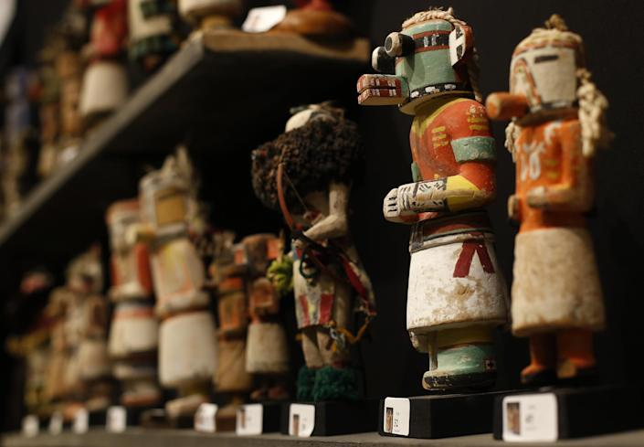Kachina dolls made by Hopi and Zuni Native American tribes are on display on the eve of their sale at the Drouot auction house in Paris on December 14, 2014 (AFP Photo/Thomas Samson)