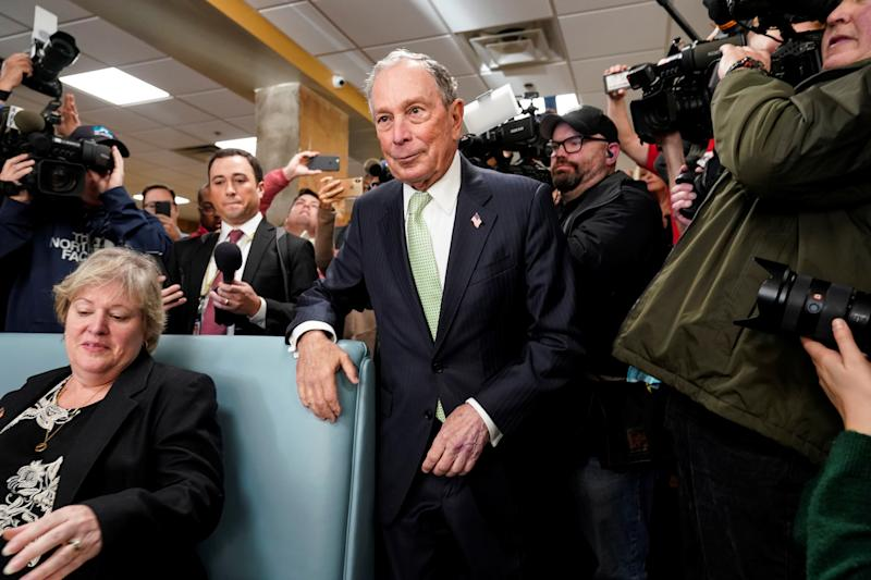 Former New York Mayor Michael Bloomberg arrives to speak with Virginia House Delegate-elect Nancy Guy after launching his presidential campaign in the D'Egg cafe in Norfolk, Virginia, U.S., November 25, 2019. REUTERS/Joshua Roberts