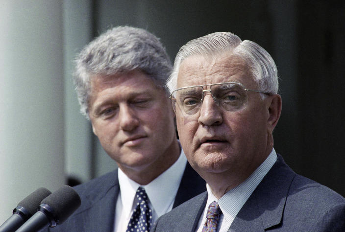FILE - In this June 1993 file photo, President Bill Clinton stands behind his nominee for Ambassador to Japan, former Vice President Walter Mondale. Mondale, a liberal icon who lost the most lopsided presidential election after bluntly telling voters to expect a tax increase if he won, died Monday, April 19, 2021. He was 93. (AP Photo/Greg Gibson, File)