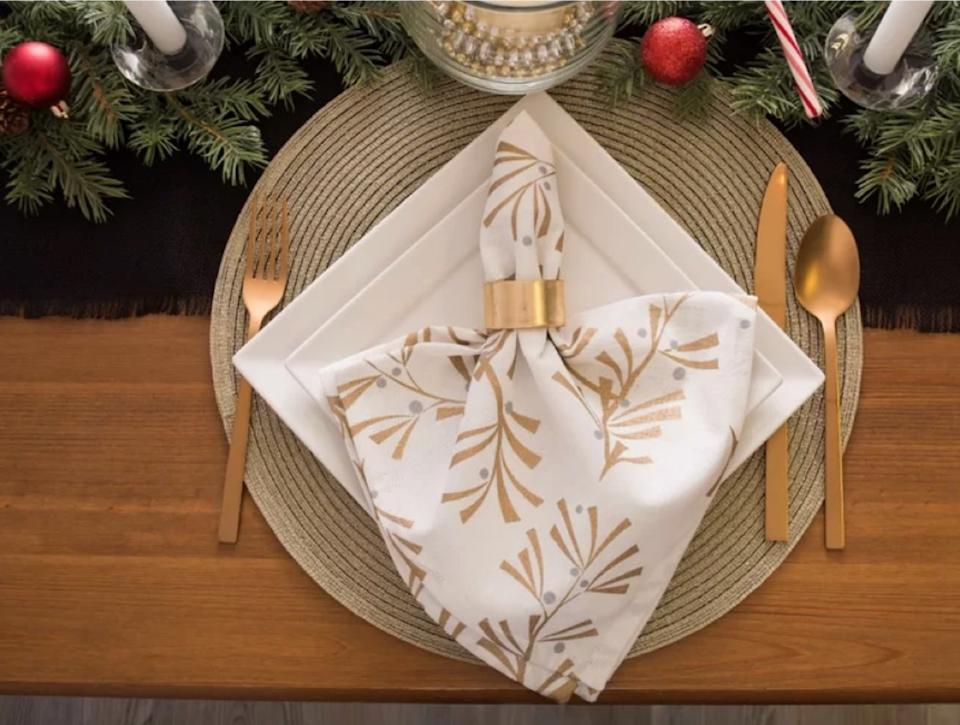 square white plates, gold-toned silverware, and white napkin with gold leaves, fall decorating tips