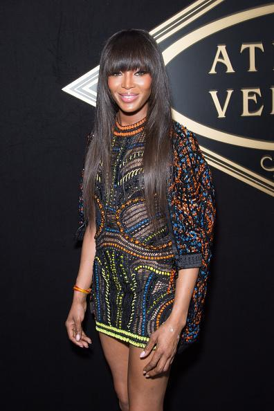<p>Queen of fashion Noami Campbell arrives at the Versace show in a colourful ensemble.<i> [Photo: Rex Features]</i></p>