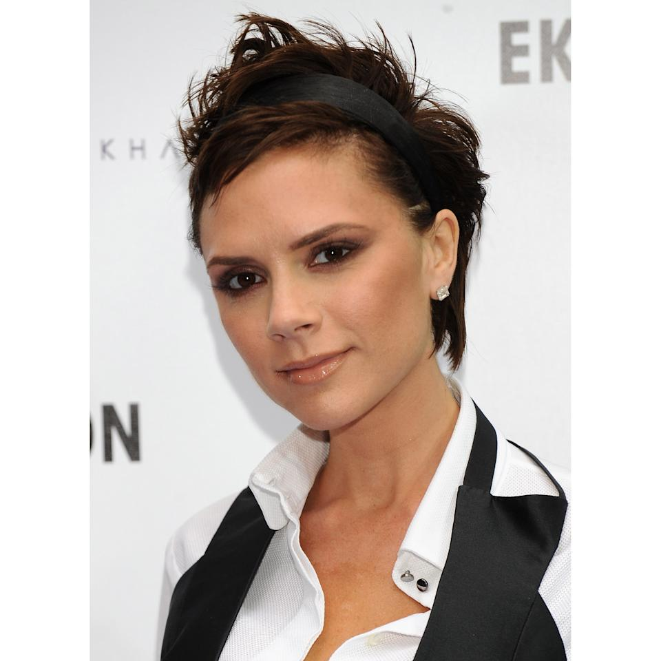 <p>VB is the <em>queen</em> of the slight smile, as evidenced by this photo taken at her dVb By Victoria Beckham event in 2008. It seems to be her go-to when she's photographed – she gives us just enough of a smirk to keep us coming back for more!</p>