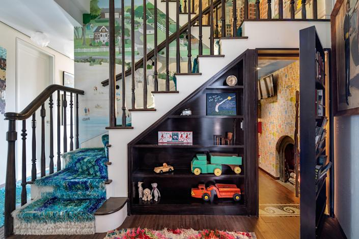 The home has two playrooms—one of which is located beneath a staircase and is decked out with monkey bars and an intercom to the second playroom.