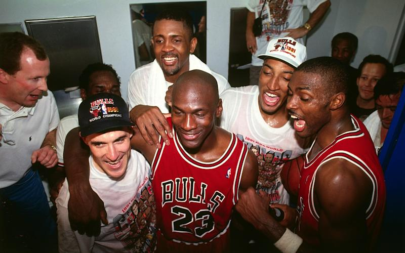 Michael Jordan and his Chicago Bulls team mates celebrating a win against the Los Angeles Lakers in 1991 - Getty/NBAE