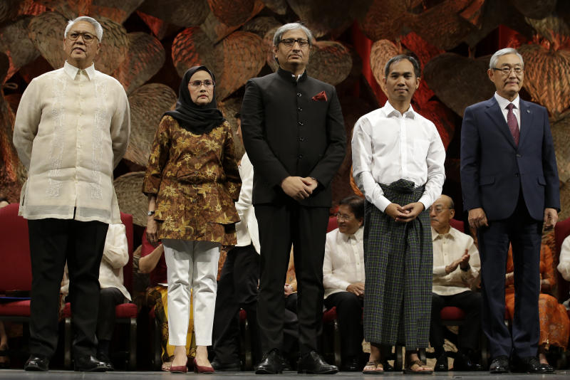 Ramon Magsaysay 2019 awardees, from left; Filipino Raymundo Pujante Cayabyab, Thai Angkhana Neelapaijit, Indian Ravish Kumar, Burmese Ko Swe Win and South Korean Kim Jong-Ki poses during ceremonies in Manila, Philippines Monday, Sept. 9, 2019. Five people are being honored as this year's winners of the Ramon Magsaysay Awards, regarded as Asia's version of the Nobel Prize, including a South Korean who helped fight bullying and suicide and a Thai housewife who became a human rights defender after losing her husband to violence in southern Thailand. (AP Photo/Aaron Favila)