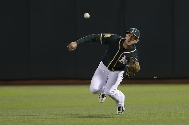Oakland Athletics right fielder Stephen Piscotty catches a fly ball hit by Seattle Mariners' John Andreoli during the seventh inning of a baseball game in Oakland, Calif., Wednesday, May 23, 2018. (AP Photo/Jeff Chiu)