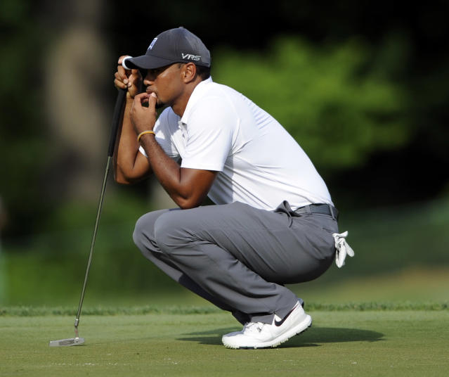 Tiger Woods waits on the 18th green during the second round of the Quicken Loans National golf tournament, Friday, June 27, 2014, in Bethesda, Md. Wood ended the day at 7-over-par 149 and missed the cut. (AP Photo/Nick Wass)