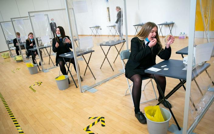 Students takes a COVID-19 test at Oasis Academy  - PA