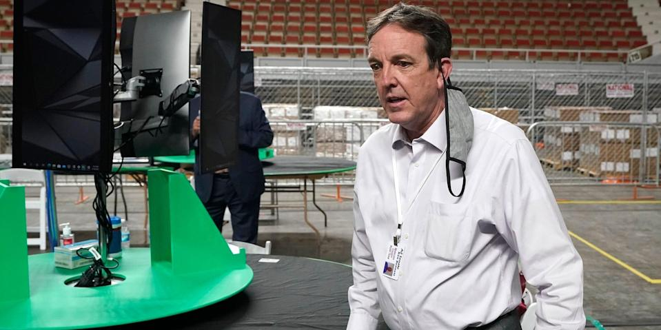 In this Thursday, April 22, 2021, file photo, former Arizona Secretary of State Ken Bennett arrives at a news conference to talk about overseeing a 2020 election ballot audit ordered by the Republican lead Arizona Senate at the Arizona Veterans Memorial Coliseum in Phoenix.