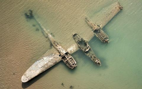 The Lockheed P-38 Lightning smashed into the sand at Harlech, North Wales - Credit: Wales News Service