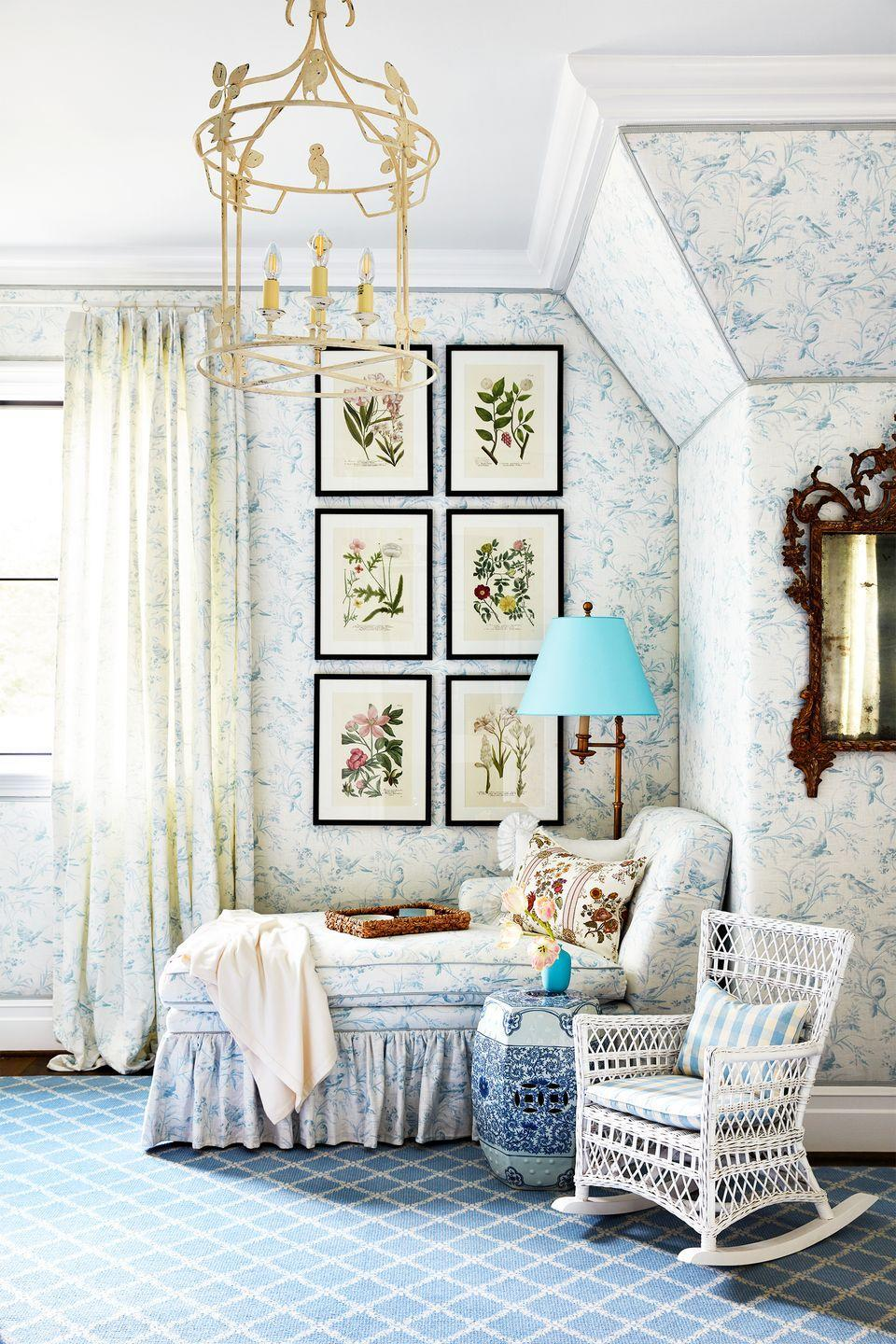 """<p>Who says gender neutral nurseries can't also boast traditional decor? A sweet shade of blue, along with whimsical patterns, and delicate furniture is a go-to for a reason. <a href=""""https://www.housebeautiful.com/room-decorating/a29342573/whole-home-2019-kids-rooms/"""" rel=""""nofollow noopener"""" target=""""_blank"""" data-ylk=""""slk:Amy Berry"""" class=""""link rapid-noclick-resp"""">Amy Berry</a> incorporated a chaise and rocking chair for reading and brought the room to life with a classic toile wallpaper and framed botanical prints. It's a lovely place for any baby to grow.</p>"""