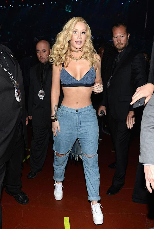 <p>The rapper took the denim-on-denim trend to new heights, wearing a denim bra with a pair of blue jeans. (Photo: Getty Images) </p>