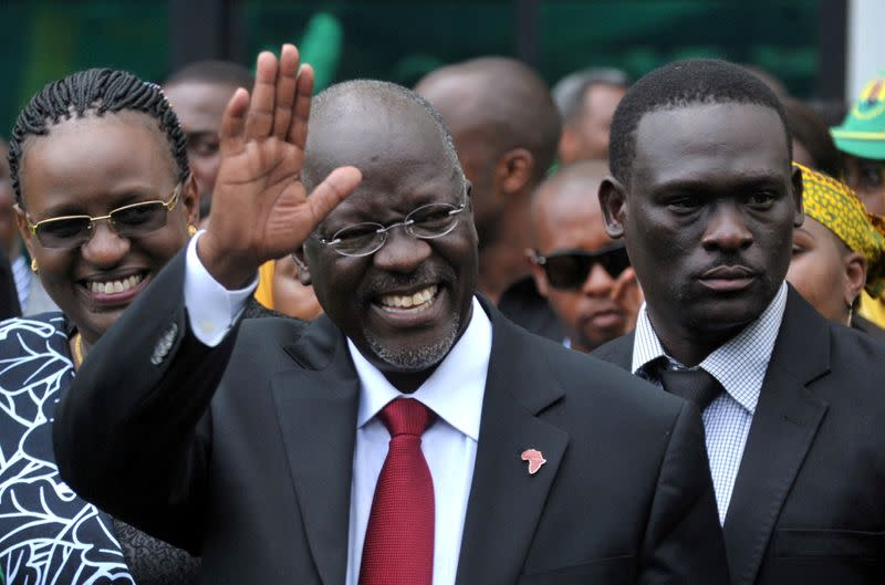 FILE PHOTO: Tanzania's President elect Magufuli salutes members of the ruling CCM at the party's sub-head office on Lumumba road in Dar es Salaam