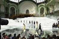 <p>Continuing her stream of more understated show sets, creative director Virginie Viard transformed the Grand Palais into a minimalist map. A more graphic take on the environmental theme that has run throughout fashion month, Viard had guests sit on swirling white benches that, from an aerial view, revealed themselves to be ordnance survey lines that you would find on a geographical map.</p>
