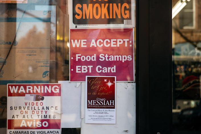 Food stamps sign in New York on Dec. 5, 2019. The Biden administration on Monday announced a permanent expansion of the food stamps program of more than 25% beginning in October 2021.