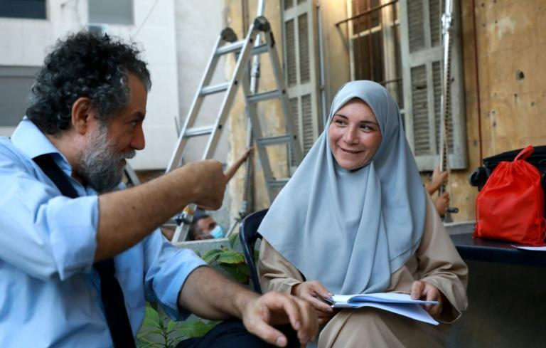 "Actors Mohammad Akil (L) and Mireille Panossian on the set of the short movie ""Abbas and Fadel"", part of the ""Beirut 6:07"" series streaming platform Shahid VIP on October 17"