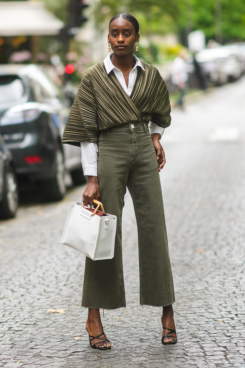 <p>How about this fab example of taking your 'going out' outfit into the office, by layering loose party tops over a white shirt and teaming with cropped jeans.</p>