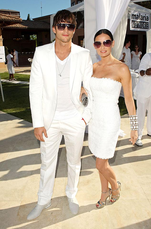 "Gorgeous couple alert! Ashton Kutcher and his wife Demi Moore made an appearance at Diddy's annual White Party and looked better than ever. The man-boy opted for a crisp white suit and V-neck tee, while his lady love donned an Andrew GN crocheted dress, monstrous cuff, and silver strappy sandals. Jason Merritt/<a href=""http://www.gettyimages.com/"" target=""new"">GettyImages.com</a> - July 4, 2009"