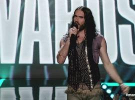 Russell Brand Risks Wrath Of Hollywood With Travolta Jibes