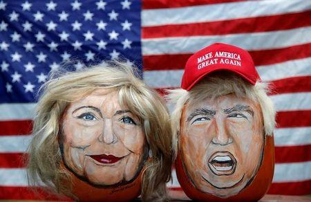 The images of U.S. Democratic presidential candidate Hillary Clinton (L) and Republican Presidential candidate Donald Trump are seen painted on decorative pumpkins created by artist John Kettman in LaSalle, Illinois, U.S., June 8, 2016.     REUTERS/Jim Young