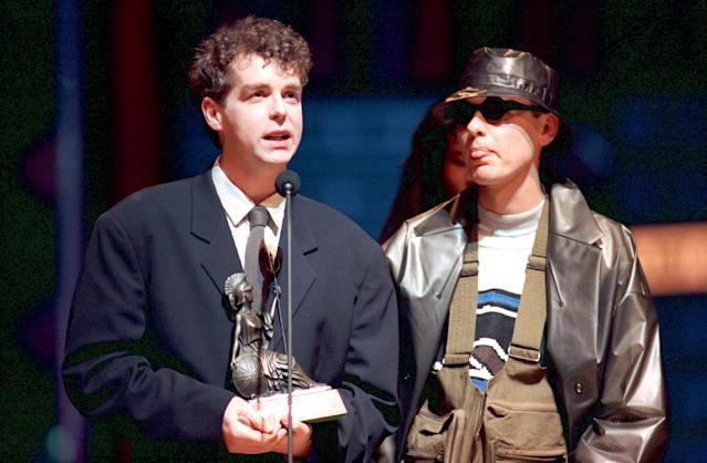 Chris Lowe, left, and Neil Tennant of the Pet Shop Boys accept their award at the British Industry Awards at the Royal Albert Hall in London, England, Monday evening, Feb. 8, 1988. (AP Photo/Gill Allen)