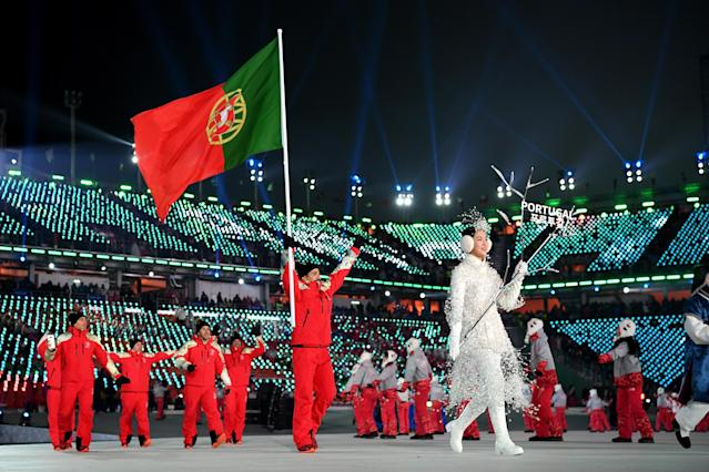 <p>Flag bearer Kequyen Lam of Portugal and teammates during the Opening Ceremony of the PyeongChang 2018 Winter Olympic Games at PyeongChang Olympic Stadium on February 9, 2018 in Pyeongchang-gun, South Korea. (Photo by Matthias Hangst/Getty Images) </p>