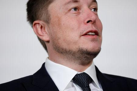 FILE PHOTO - Elon Musk, founder, CEO and lead designer at SpaceX and co-founder of Tesla, speaks at the International Space Station Research and Development Conference in Washington