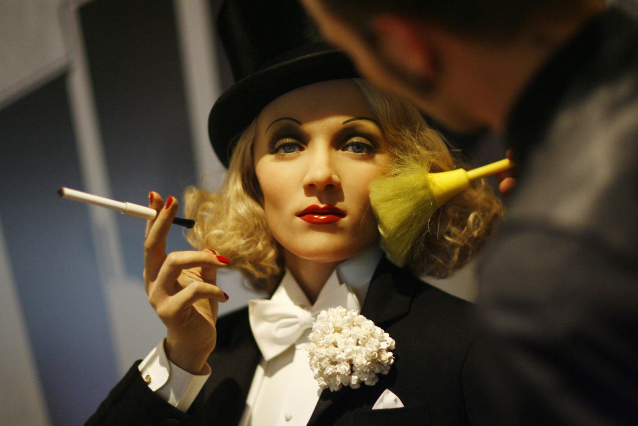 An artist brushes the face of wax figure of actress and singer Marlene Dietrich at the site of Madame Tussaud's Wax Museum in Berlin May 28, 2008. The new museum will open in July. REUTERS/Johannes Eisele
