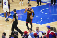 Atlanta Hawks' Trae Young reacts after the Hawks won Game 7 in a second-round NBA basketball playoff series against the Philadelphia 76ers, Sunday, June 20, 2021, in Philadelphia. (AP Photo/Matt Slocum)