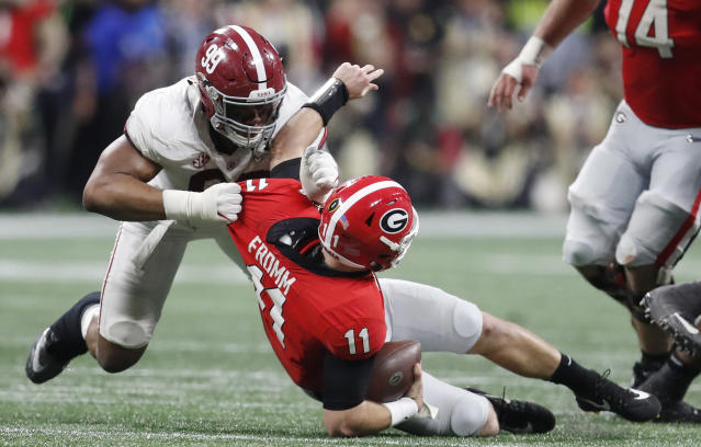 FILE - In this Jan. 8, 2018, file photo, Alabama's Raekwon Davis sacks Georgia's Jake Fromm during the second half of the NCAA college football playoff championship game, in Atlanta. The SEC, a conference that prides itself on producing great defensive linemen and linebackers, must find candidates to replace all the guys heading into the pros. Alabamas Raekwon Davis and Auburns Derrick Brown both enter the summer as legitimate All-America candidates as they attempt to lead their teams. (AP Photo/David Goldman, File)
