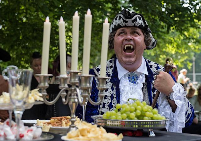 "<p>A participant of the so called ""Victorian Picnic"" smiles in a fancy costume during the Wave Gothic Festival (WGT) in Leipzig, Germany, Friday, June 2, 2017. (AP Photo/Jens Meyer) </p>"