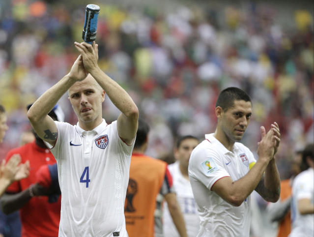 United States' Michael Bradley, left, and Clint Dempsey applaud after qualifying for the next World Cup round following their 1-0 loss to Germany during the group G World Cup soccer match between the USA and Germany at the Arena Pernambuco in Recife, Brazil, Thursday, June 26, 2014. (AP Photo/Ricardo Mazalan)