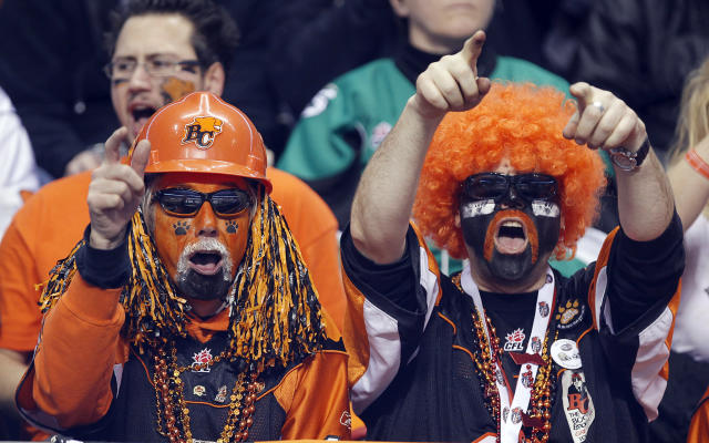 VANCOUVER, CANADA - NOVEMBER 27: Fans of the B.C. Lions celebrate a play against the Winnipeg Blue Bombers during the CFL 99th Grey Cup November 27, 2011 at BC Place in Vancouver, British Columbia, Canada. (Photo by Jeff Vinnick/Getty Images)