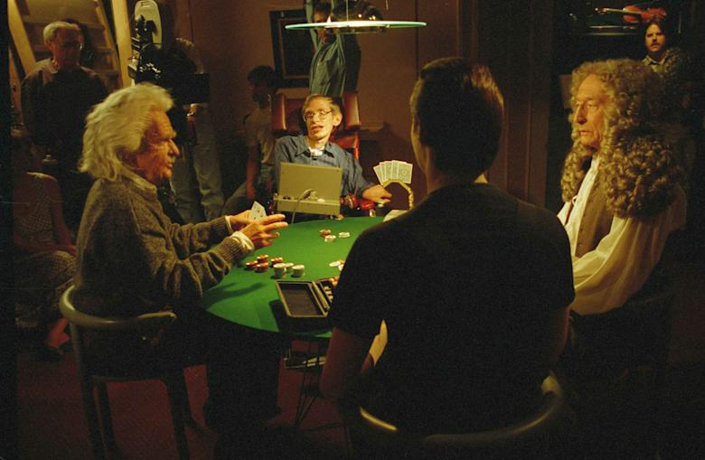 """Theoretical physicist Stephen Hawking, second from left, makes a guest appearance on """"Star Trek; The Next Generation,"""", Los Angeles, Calif. The episode features a scene in which the character Data, back to the camera, participates in a poker game with a group of brilliant scientific figures consisting of Hawking, Einstein, and Newton. The actors are unidentified Stephen Hawking TV Show 1993, Los Angeles, USA"""
