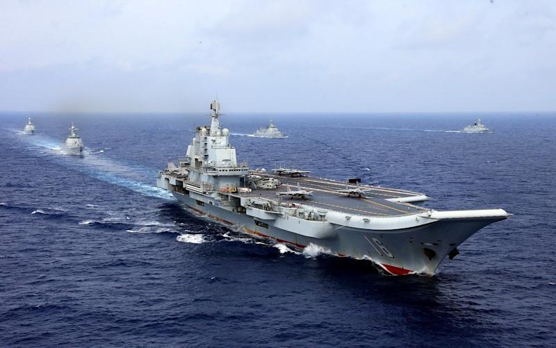 China's aircraft carrier Liaoning takes part in a military drill of Chinese People's Liberation Army (PLA) Navy