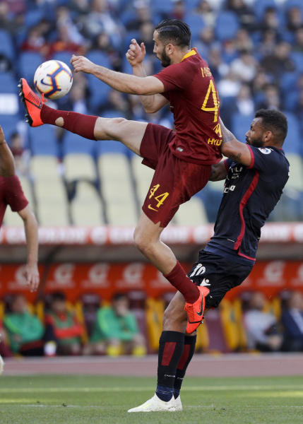 Roma's Kostas Manolas, left, and Cagliari's Galvao Joao Pedro fight for the ball during a Serie A soccer match between Roma and Cagliari, at Rome's Olympic Stadium, Saturday, April 27, 2019. (AP Photo/Gregorio Borgia)