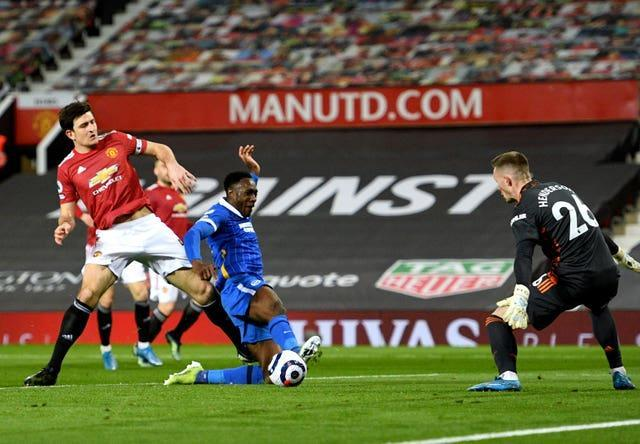 Manchester United's Harry Maguire challenges Brighton's Danny Welbeck