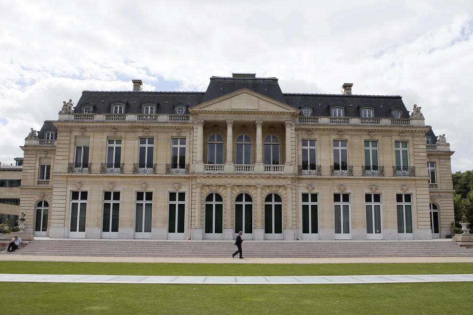 FILE - In this June 7, 2017 file photo, the Organisation for Economic Co-operation and Development (OECD) headquarters is pictured in Paris, France. Some 130 countries have backed a global minimum tax as part of a worldwide effort to keep multinational firms from dodging taxes by shifting their profits to countries with low rates. The agreement announced by the Organization for Economic Cooperation and Development Thursday also provides for taxing the largest global companies in countries where they earn profits through online businesses but may have no physical presence.(AP Photo/Francois Mori, File)