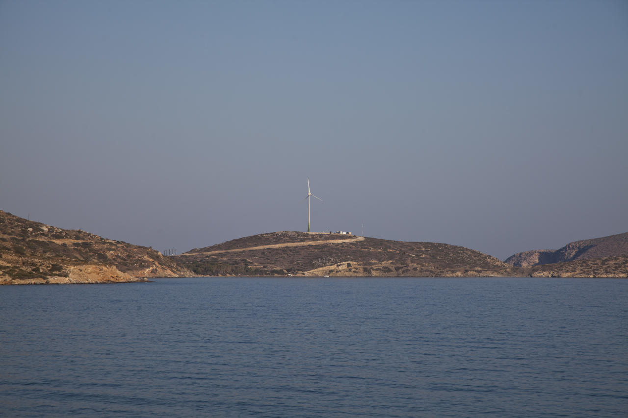 In this photo dated Thursday, Aug. 9, 2018, a wind turbine on the Aegean island of Tilos, Greece. Tilos with its winter population of 400 and summer population of some 3000, stands on the brink of becoming the first island in the Mediterranean to run exclusively on wind and solar power when the blades of the 800 kilowatt wind turbine start turning. (AP Photo/ Iliana Mier)