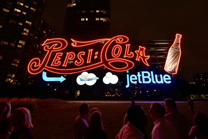 PepsiCo and JetBlue light up the sky in Long Island City, New York in celebration of the new partnership between these two New York-based companies. For the first time ever, PepsiCo temporarily added JetBlue branding to its world-famous Pepsi-Cola sign, which will be visible to New Yorkers and visitors through September.