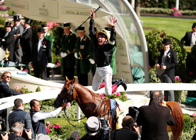 Horse Racing - Royal Ascot - Ascot Racecourse, Ascot, Britain - June 21, 2018 Frankie Dettori jumps off Stradivarius in celebration after winning the 4.20 Gold Cup Action Images via Reuters/Andrew Boyers