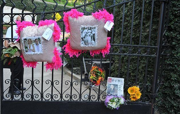 Fans have left flowers and cards outside the Playboy Mansion mourning Hugh following his death. Source: Getty