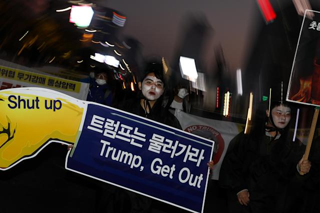 <p>Demonstrators march toward the U.S. Embassy during a protest ahead of President Donald Trump's visit in Seoul, South Korea, on Saturday, Nov. 4, 2017. (Photo: Seong Joon Cho/Bloomberg via Getty Images) </p>